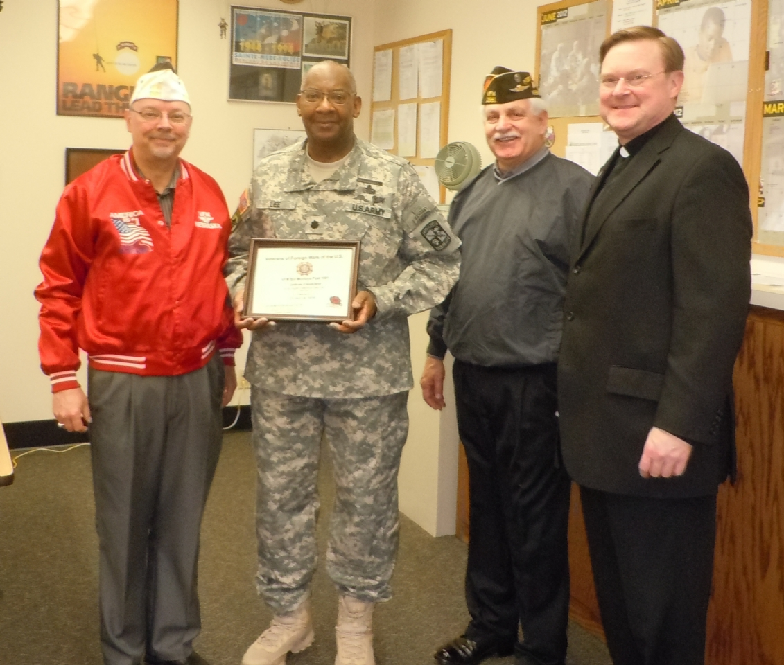 Presentation to Col. Lee and Father Stephan Boes